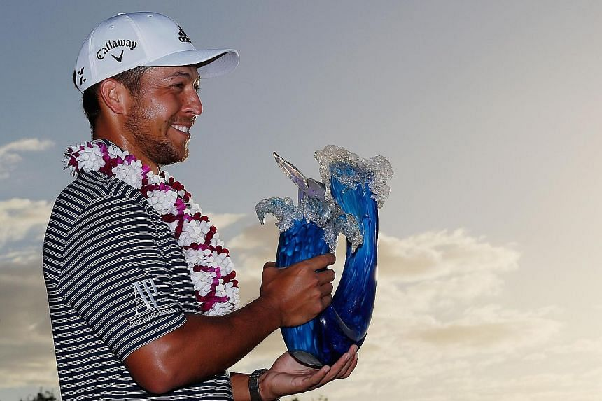 A joyous Xander Schauffele after winning the Tournament of Champions at the Plantation Course at Kapalua Golf Club in Hawaii.
