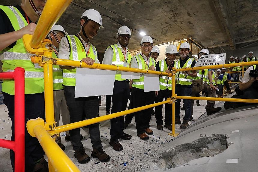 From far left: Senior Parliamentary Secretary for Transport Baey Yam Keng, Senior Minister of State for Transport Janil Puthucheary and Mountbatten MP Lim Biow Chuan at the Katong Park MRT station work site yesterday. Dr Janil broke through a tunnel