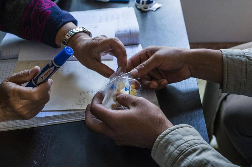 A drug user receiving medicine as part of his treatment at a local centre in Taunggyi, Shan State, that is run by the Myanmar Anti-Narcotics Association.