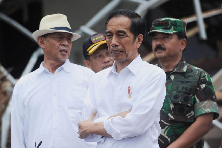 Indonesian President Joko Widodo (centre) has said more money will be channelled toward disaster education and response.