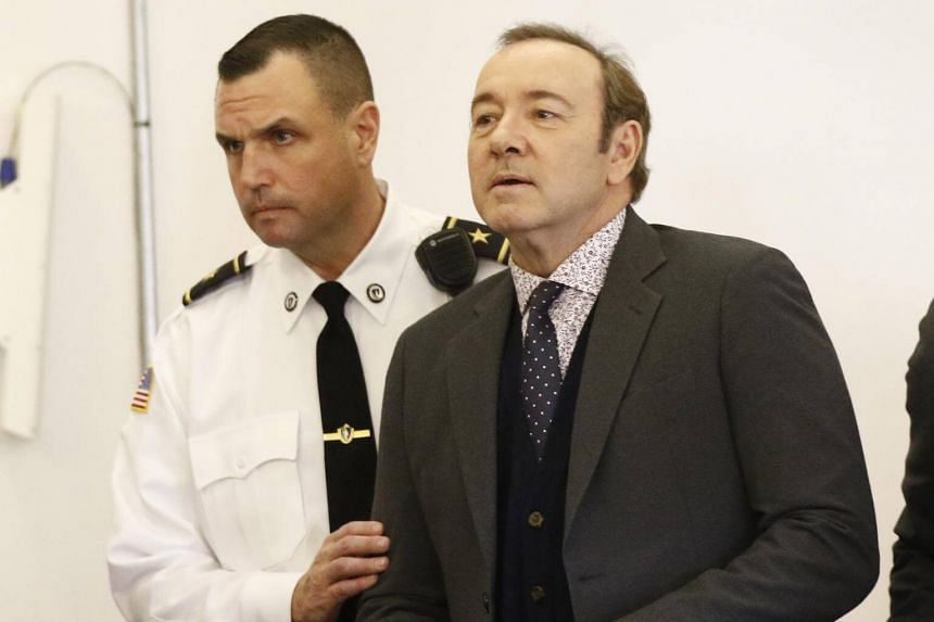 Actor Kevin Spacey (right) is escorted by a court officer as he appears at the Nantucket District Court in Nantucket, Massachusetts, on Jan 7, 2019.