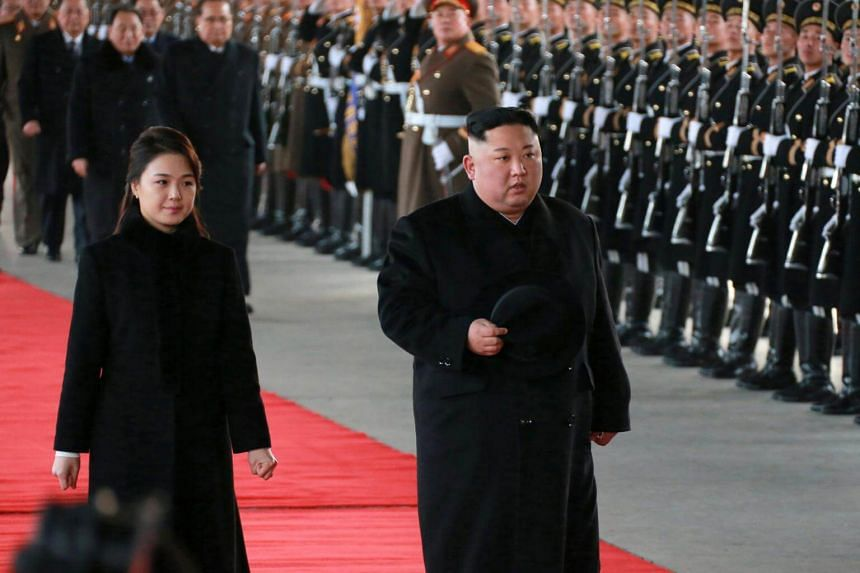 North Korean leader Kim Jong Un (right) and his wife Ri Sol-ju leaving Pyongyang, North Korea for China on Jan 7, 2019.