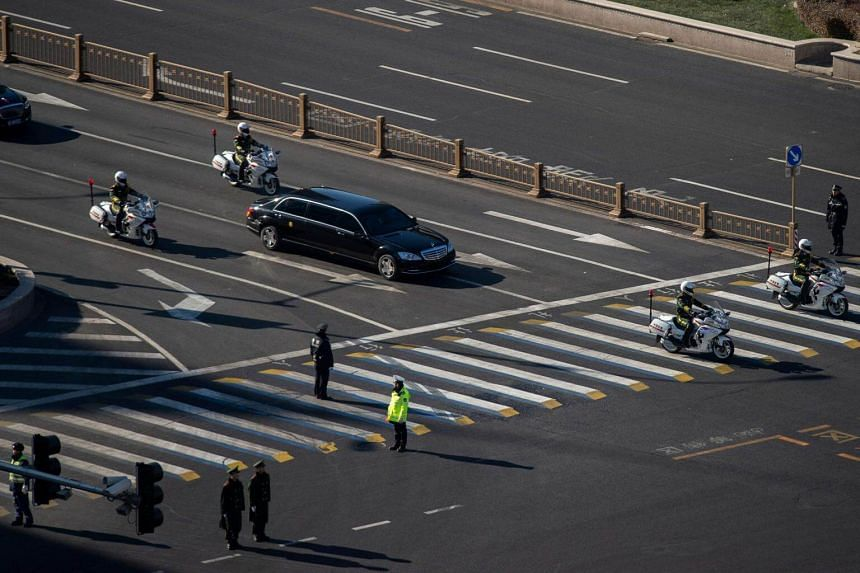 A vehicle that is part of a motorcade that is believed to be carrying North Korean leader Kim Jong Un makes its way through central Beijing, on Jan 8, 2019.