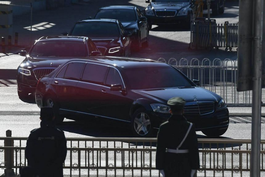 Cars in the motorcade of North Korean leader Kim Jong Un leave from Beijing Railway Station, on Jan 8, 2019.