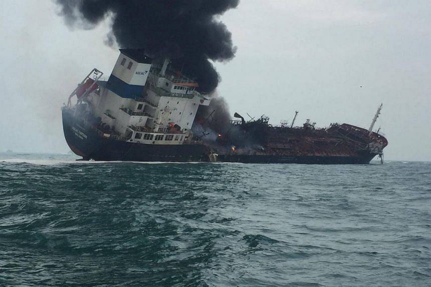 Smoke rising from an oil tanker, which caught fire off the coast in Hong Kong's southern waters on Jan 8, 2019.