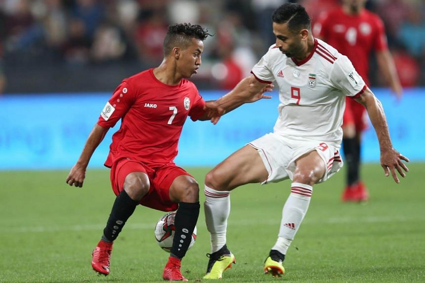 Omid Ebrahimi Zarandini (right) of Iran in action against Ahmed Al Sarori of Yemen during the 2019 AFC Asian Cup group D preliminary round match between Iran and Yemen in Abu Dhabi, United Arab Emirates, on Jan 7, 2019.