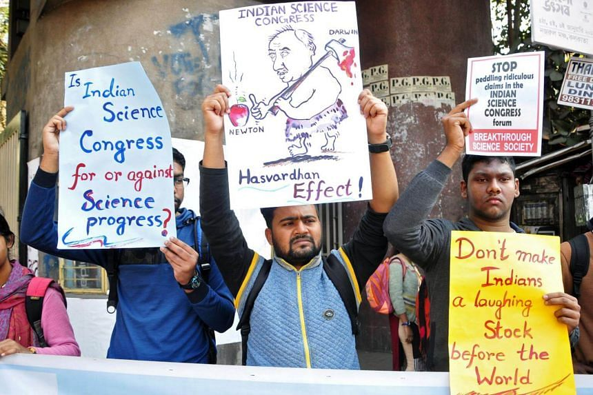 People hold placards to protest against claims made by speakers, discrediting theories of Isaac Newton and Albert Einstein, at the 106th Indian Science Congress in Kolkata, India, on Jan 7, 2019.