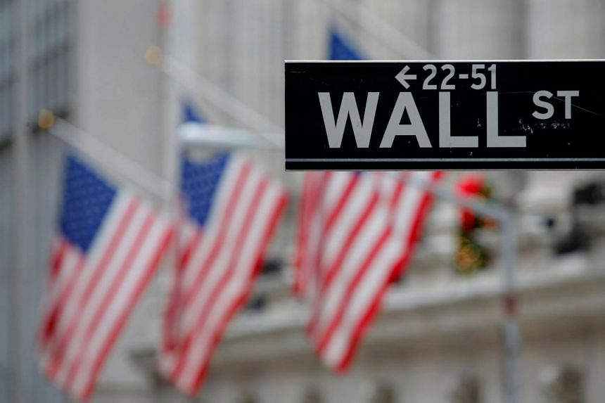 A sign for Wall Street seen outside the New York Stock Exchange in Manhattan, New York.