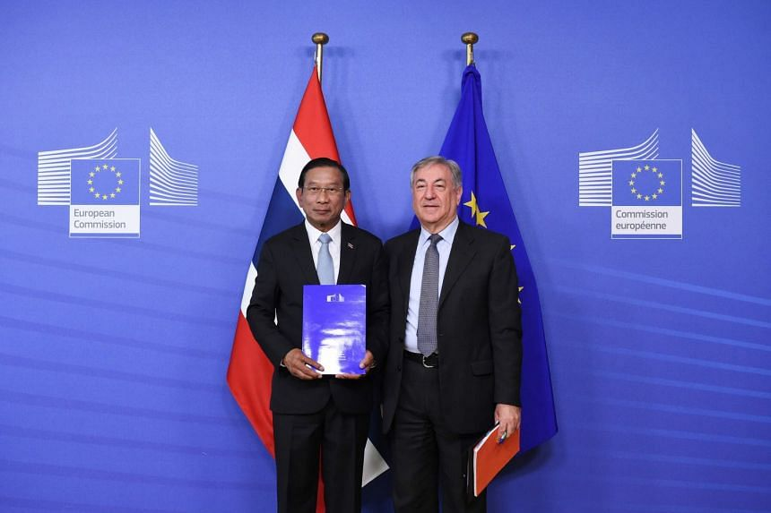 Thailand's deputy Prime Minister Chatchai Sarikulya poses with EU Commissioner of Environment, Maritime Affairs and Fisheries Karmenu Vella following their meeting on the progress in the fight against Illegal, unreported and unregulated fishing on Ja