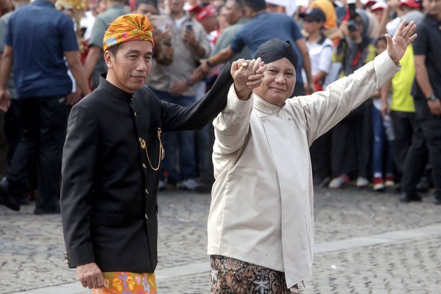 Indonesian President Joko Widodo and his challenger Prabowo Subianto at a ceremony marking the start of the campaigning period for the 2019 presidential election in Jakarta on Sept 23, 2018.
