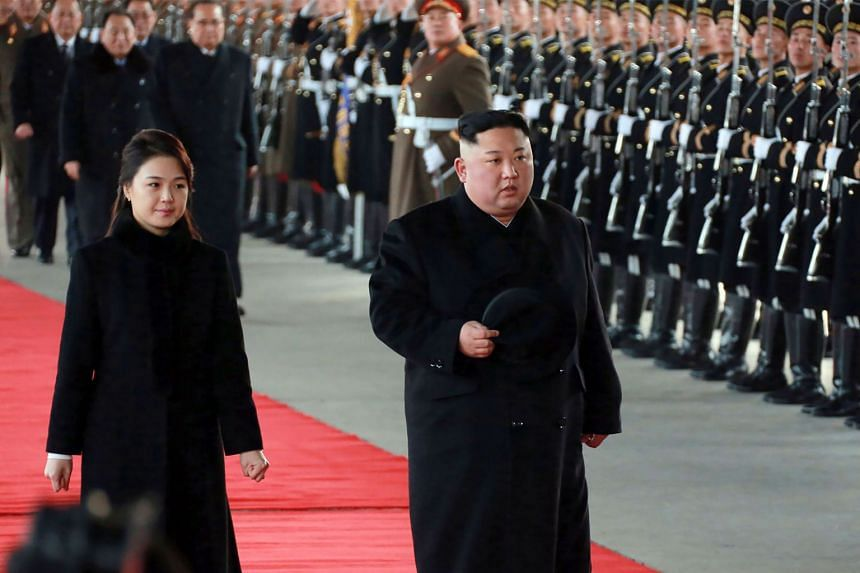 North Korean leader Kim Jong Un and his wife Ri Sol Ju leaving Pyongyang station to visit China on Jan 7, 2019.