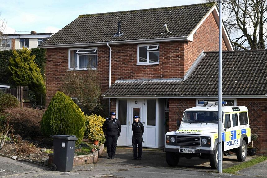 British Police Community Support Officers stand on duty outside the home of former Russian double agent Sergei Skripal, on March 6, 2018.