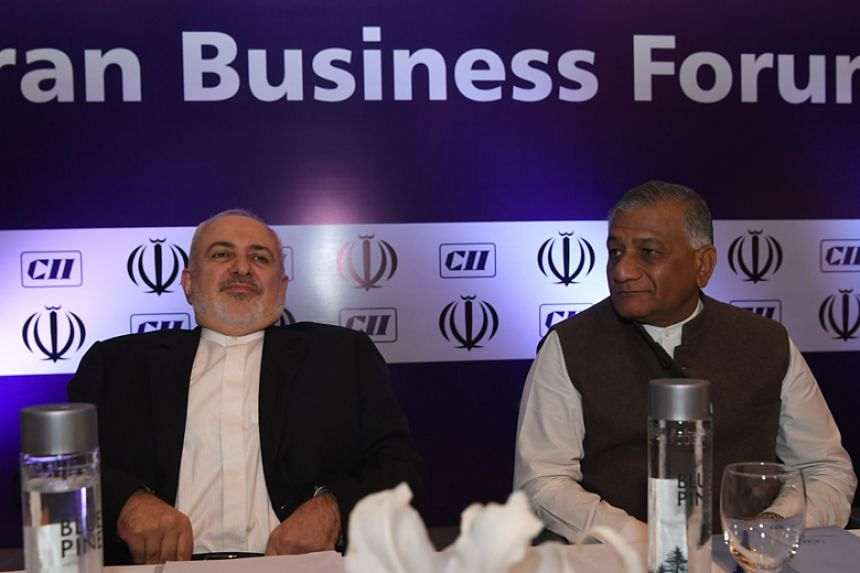Iranian Foreign Minister Javad Zarif ((left) and Indian Minister of State for External Affairs VK Singh at the India-Iran Business Forum in New Delhi on Jan 8, 2019.