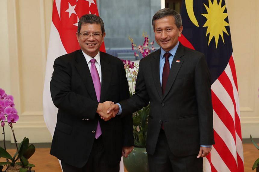 Malaysia's Foreign Minister Saifuddin Abdullah (left) met his Singapore counterpart Vivian Balakrishnan in Singapore on Jan 8, 2019, to discuss recent bilateral disputes.