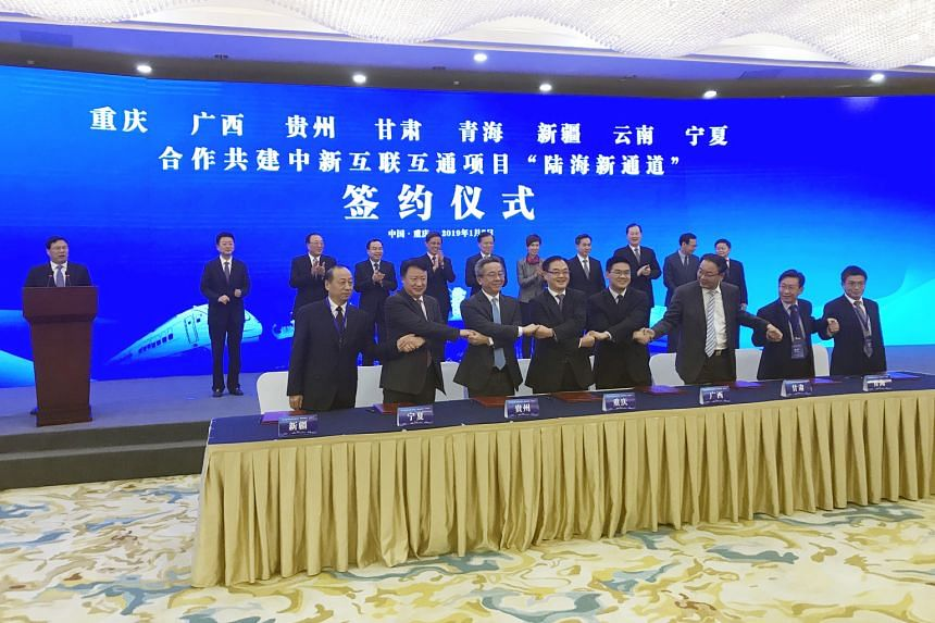 Officials of the eight Chinese provinces - Chongqing, Guangxi, Guizhou, Gansu, Qinghai, Xinjiang, Yunnan and Ningxia - signed a pact yesterday to cooperate on the building of the new land and sea trade corridor that links western China to South-east