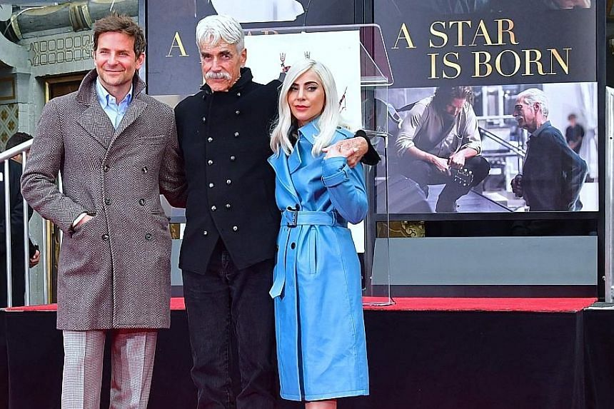 Lady Gaga (above right) and Bradley Cooper (left) did not let their Golden Globes disappointment mar the happiness of Sam Elliott (centre). They turned up on Monday to witness their 74-year-old A Star Is Born co-star imprint his hands and feet in cem