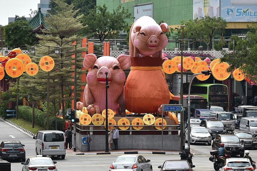 The lanternfeatures several pigs and a fu dai, or fortune bag in Mandarin. It and other lanterns at this year's Chinatown Chinese New Year light-up were designed by 11 students from the Singapore University of Technology and Design, and handmade by 4