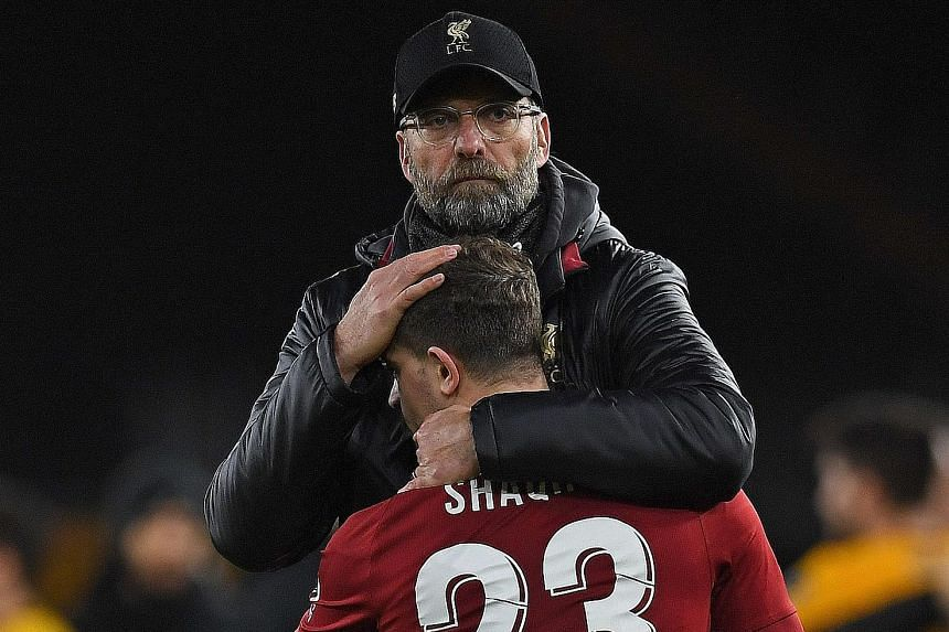Liverpool manager Jurgen Klopp consoling Swiss midfielder Xherdan Shaqiri following the Reds' 2-1 FA Cup third-round loss to Wolves on Monday. The German made nine changes to the side who lost for the first time in the Premier League this season to M