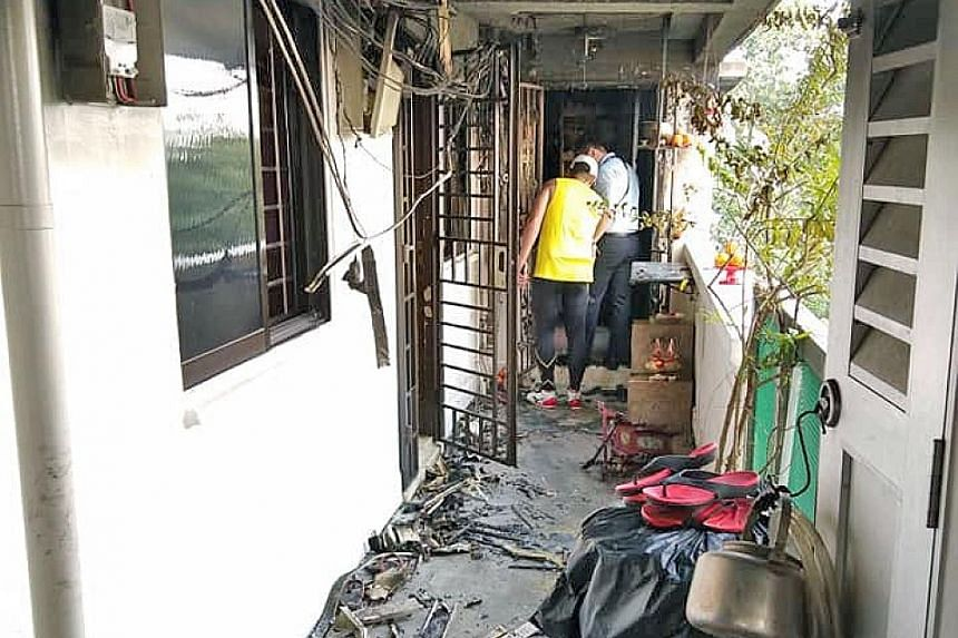 The aftermath of a fire that broke out at Block 235 Toa Payoh Lorong 8 yesterday. Neighbours rushed to the scene to help put out the fire. The Singapore Civil Defence Force finally extinguished the fire with a water jet.