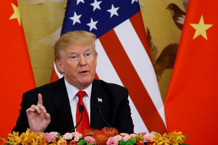 US President Donald Trump speaking at the Great Hall of the People in Beijing, China, on Nov 9, 2017.