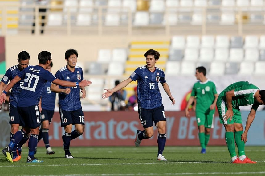 Japan's Yuya Osako celebrates scoring their first goal during the Asian Cup football match between Japan and Turkmenistan at the al-Nahyan Stadium in Abu Dhabi on Jan 9, 2019.