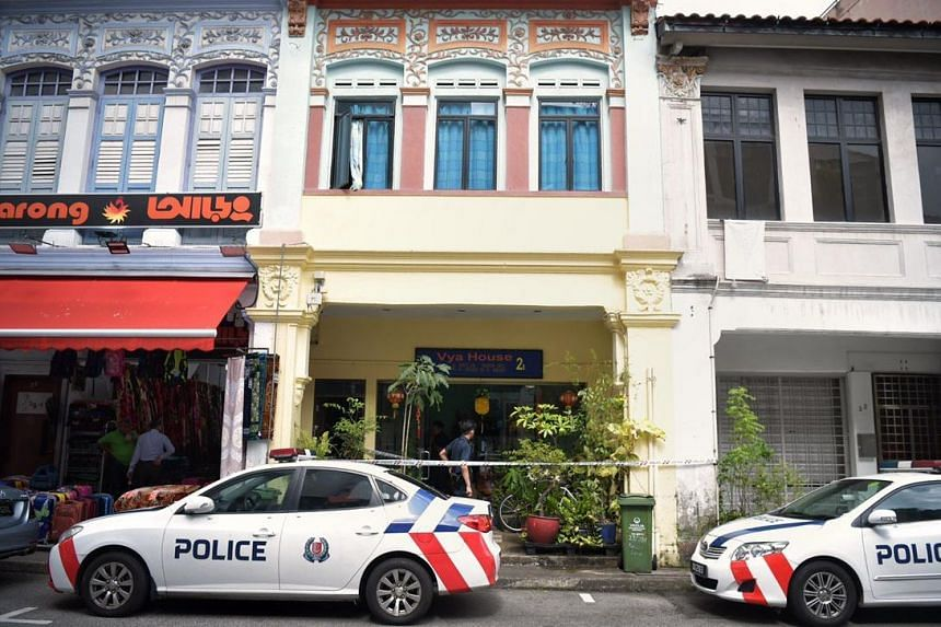 The 33-year-old was found lying motionless in a shophouse along Roberts Lane after the authorities were alerted at about 1pm.