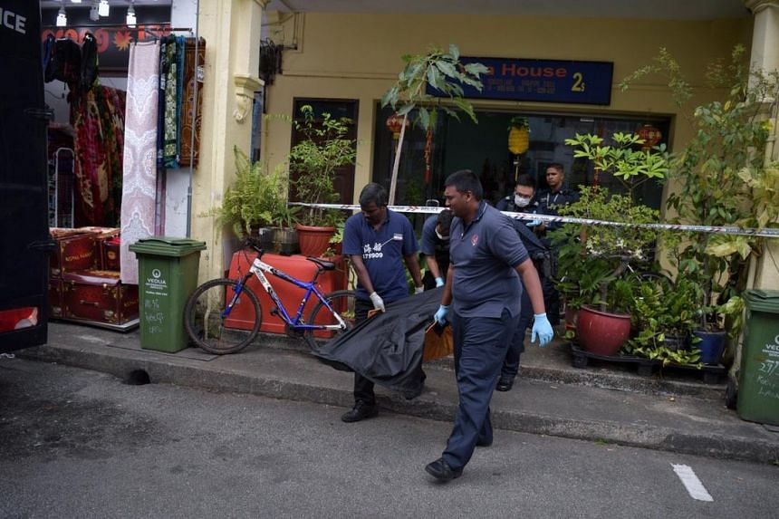 The body being removed from the shophouse at 34 Roberts Lane on Jan 9, 2019.