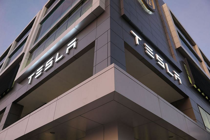 Tesla sued by parents of teen killed in fiery crash
