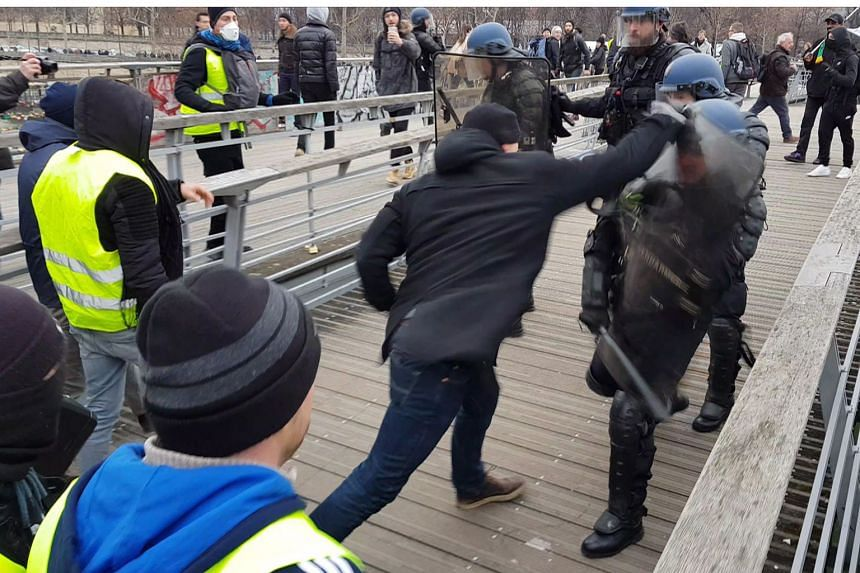 The police have at times appeared defenceless, with former heavyweight fighter Christophe Dettinger filmed landing blows on officers guarding a bridge leading to the National Assembly in Paris last Saturday. Mr Dettinger surrendered to the police the