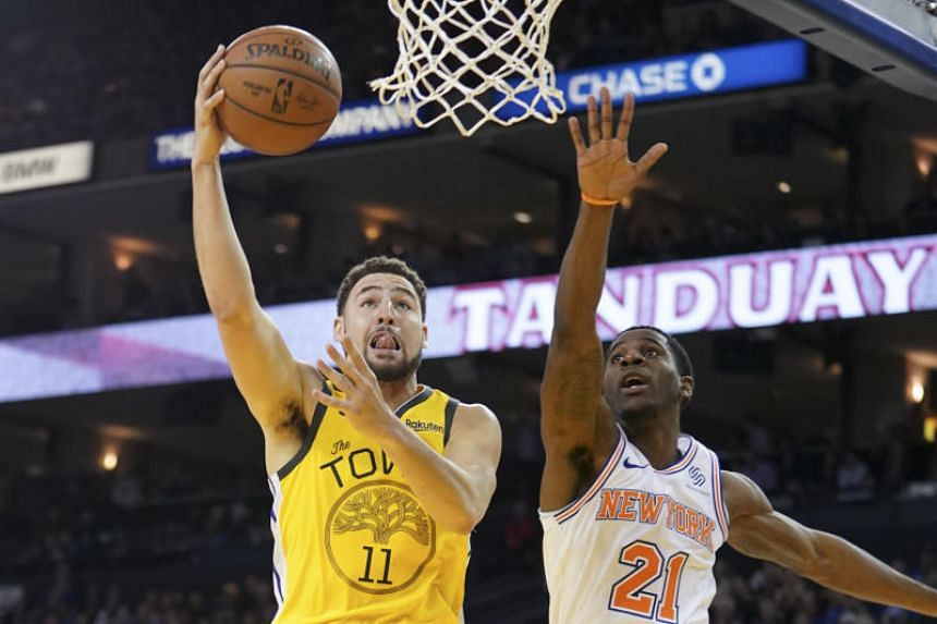 Golden State Warriors guard Klay Thompson shoots the basketball against New York Knicks guard Damyean Dotson during the fourth quarter at Oracle Arena, on Jan 8, 2019.