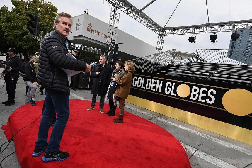 Workers and staff prepare the red carpet area for the 76th Golden Globe Awards, at the Beverly Hilton hotel in California, on Jan 5, 2019.