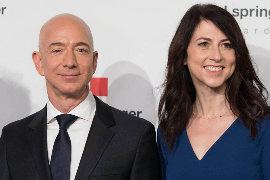 File photo of Amazon CEO Jeff Bezos and his wife MacKenzie Bezos at the headquarters of publisher Axel-Springer where he received the Axel Springer Award 2018 in Berlin.