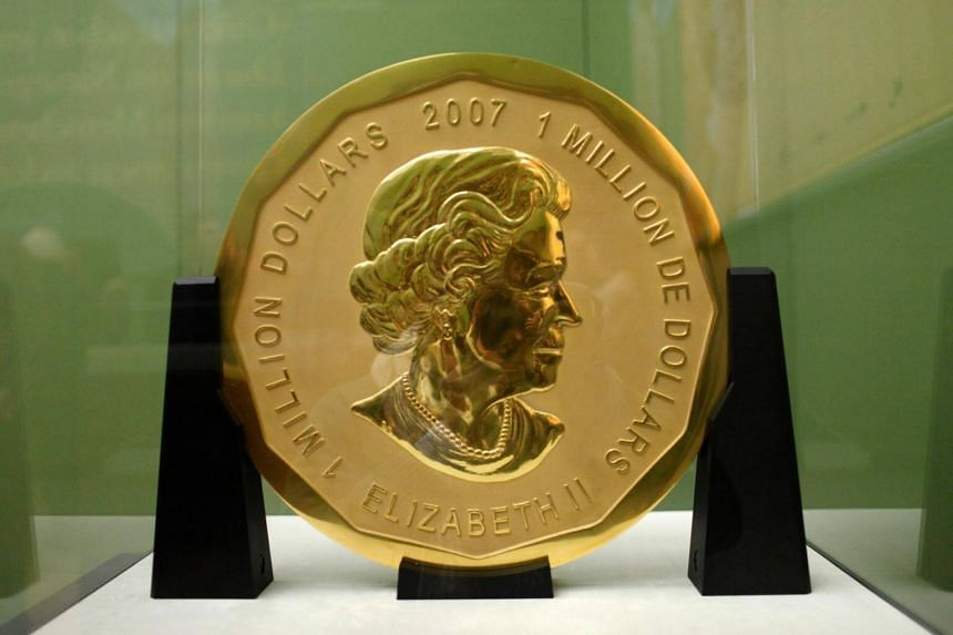 """This file photo taken on Dec 8, 2010, shows the gold coin """"Big Maple Leaf"""" on display at Berlin's Bode Museum. The coin weighs 100kg and has a diameter of 53cm."""