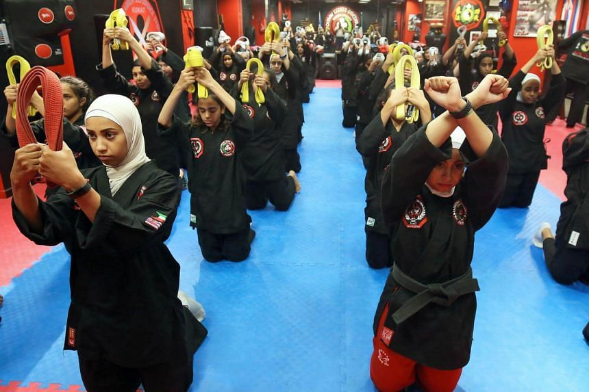 Kuwaiti women practise the hybrid martial art of Kajukenbo in a club in Kuwait City, on Oct 22, 2018.