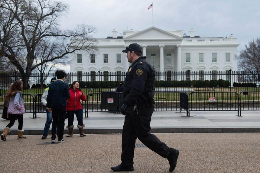 Members of the US Secret Service patrol outside the White House in Washington, DC, on Jan 9, 2019, the 18th day of the partial government shutdown.