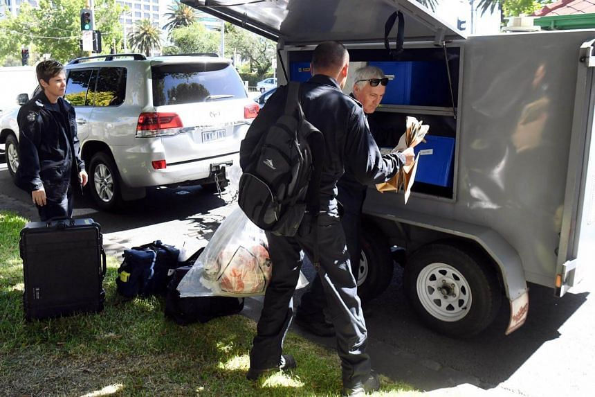 Victoria Police forensic officers load packages into a trailer outside the Italian consulate in Melbourne, on Jan 9, 2019.