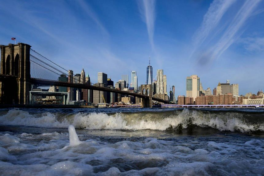 Waves from the East River are seen in front of the Brooklyn Bridge and the skyline of Manhattan in New York, on Jan 7, 2019.