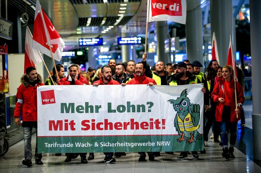 Members of the United Services Trade Union take part in a strike at Duesseldorf International Airport on Jan 10, 2019.