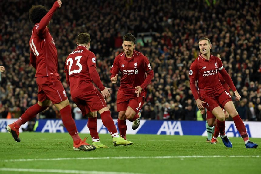 Liverpool's players celebrate a goal during the English Premier League match between Liverpool and Arsenal at Anfield in Liverpool, England, on Dec 29, 2018.