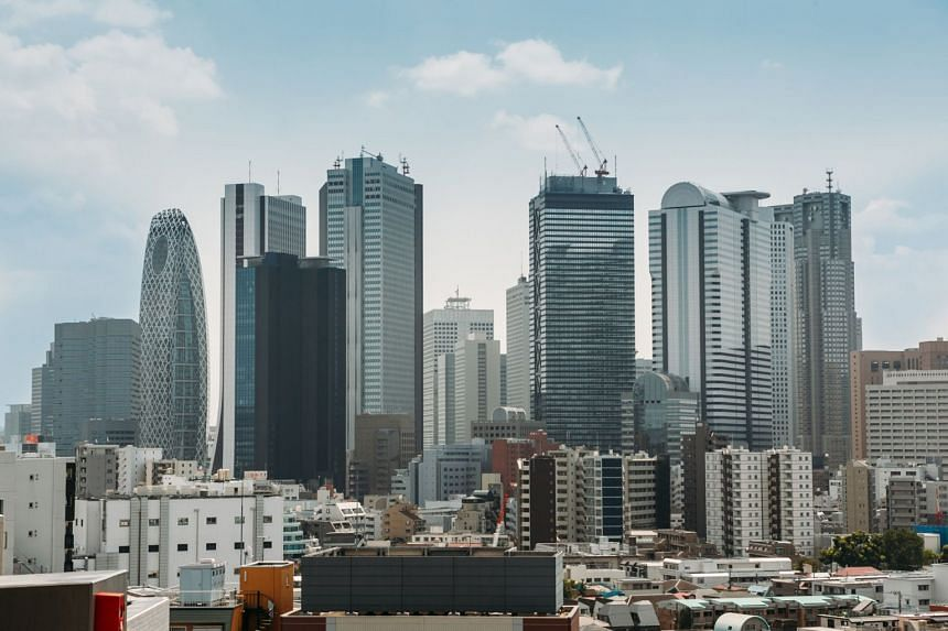 The skyline of Shinjuku in Japan. Officials are supposed to gather data from all firms with 500 or more employees but in Tokyo, only about one third of 1,400 such firms were surveyed.