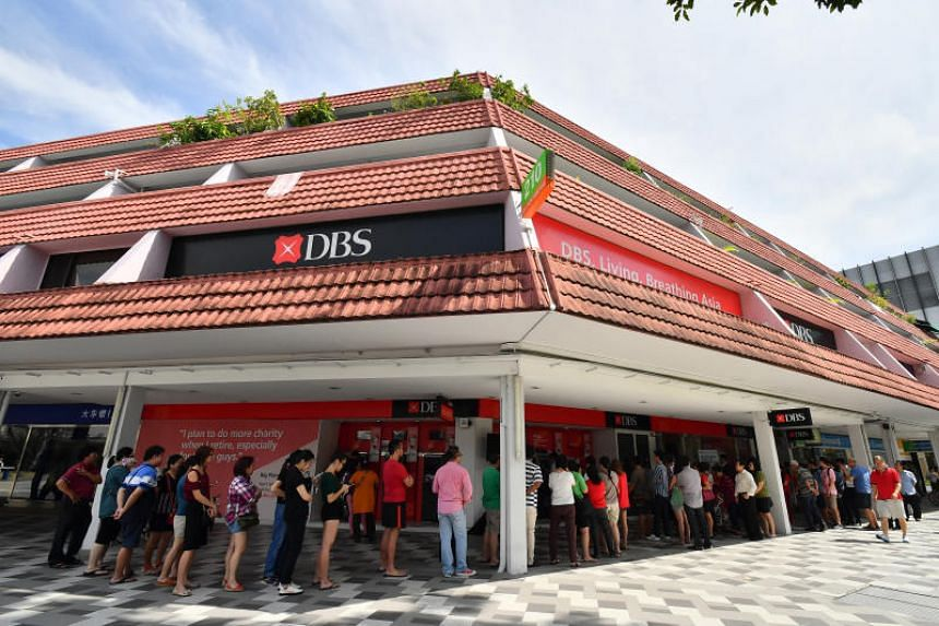 People queueing up to deposit money at a DBS Bank in Bedok on Feb 3, 2017.