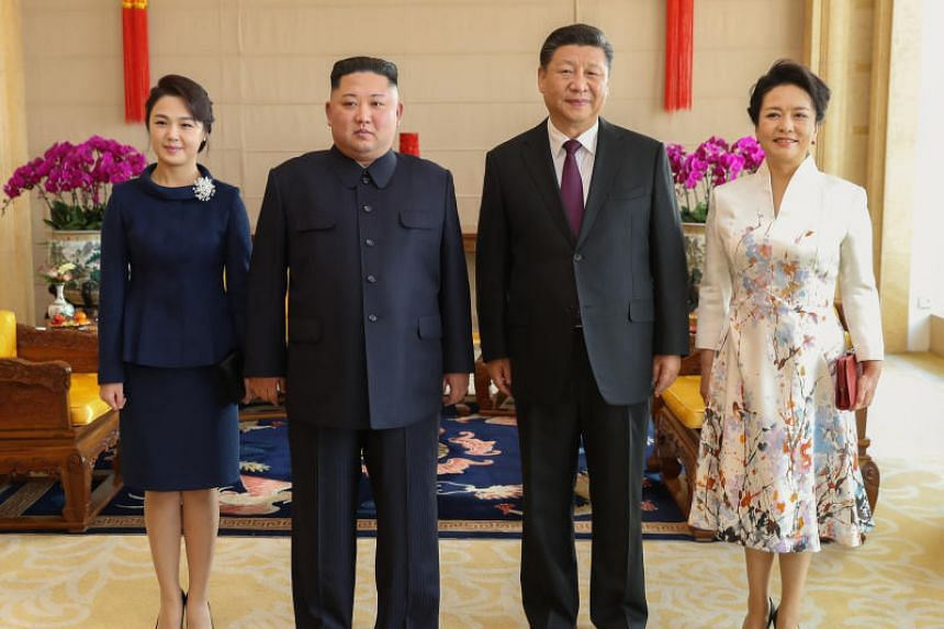 (From left) Ri Sol-ju, wife of North Korean leader Kim Jong Un; Kim Jong Un, Supreme Leader of North Korea since 2011; Chinese President Xi Jinping; and Peng Liyuan, wife of President Xi Jinping.