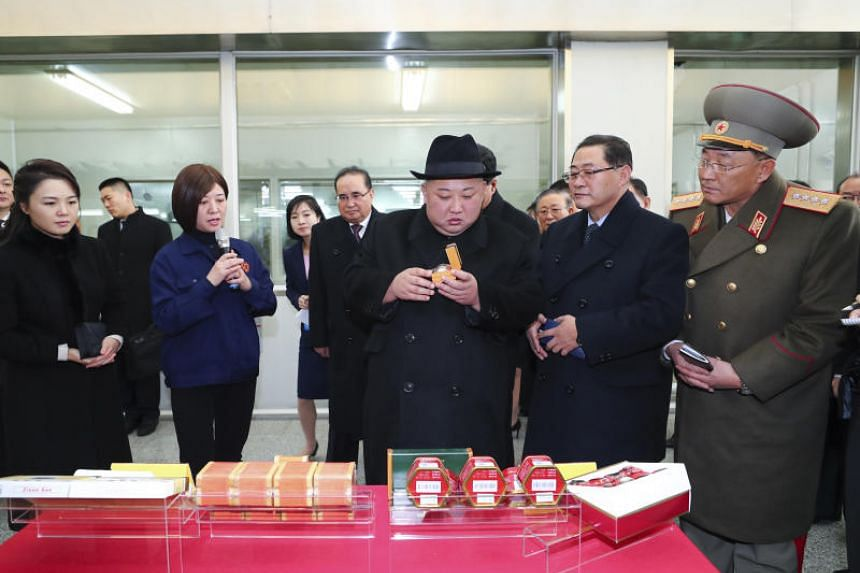 North Korean leader Kim Jong Un visits a plant owned by pharmaceutical firm Tong Ren Tang on Jan 9, 2019.