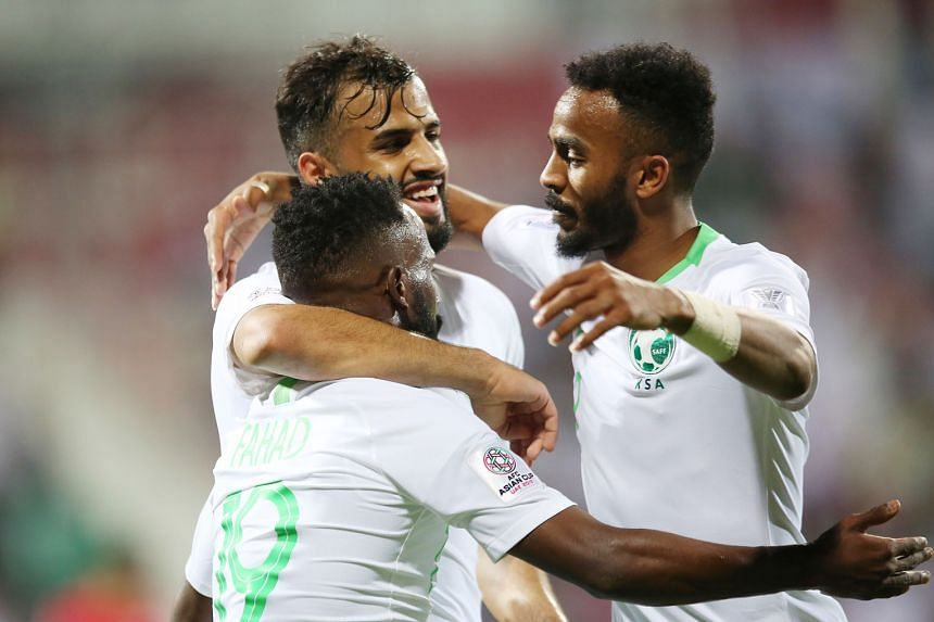 Saudi Arabia players celebrating one of their four goals. They got their Asian Cup campaign rolling with a 4-0 win over North Korea.