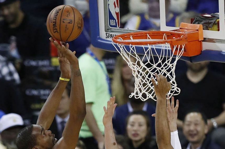 Forward Kevin Durant taking a shot en route to scoring 24 points for the Golden State Warriors at the Oracle Arena on Tuesday. The 122-95 win over the New York Knicks halted the Warriors' three-game home losing run.