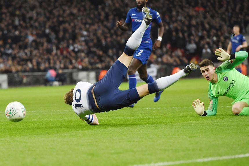 Tottenham Hotspur striker Harry Kane tumbling to the ground in the penalty box after being fouled by Chelsea goalkeeper Kepa Arrizabalaga. He converted the resulting penalty after the video assistant referee had its say.