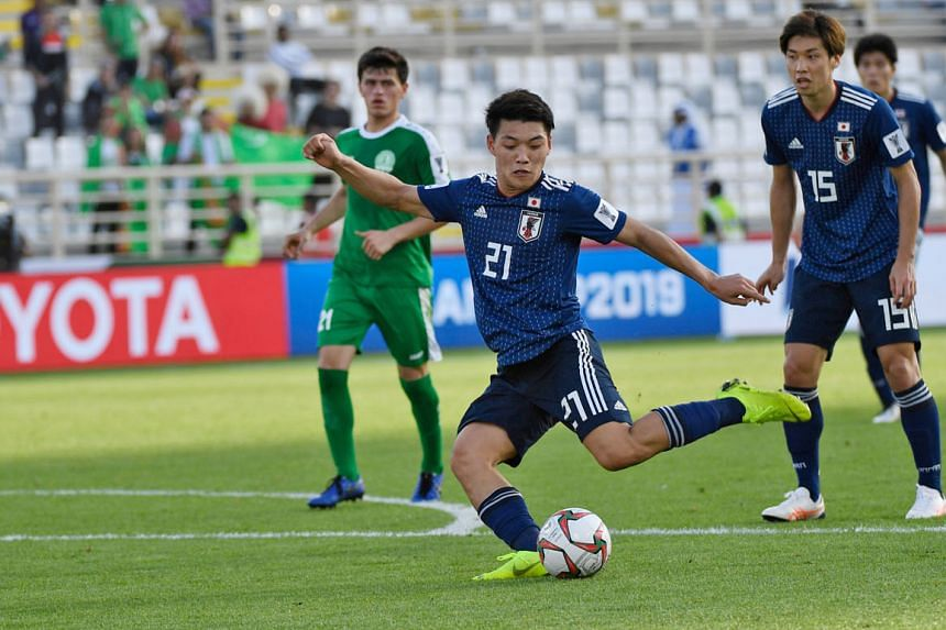 Japan's Ritsu Doan shaping to shoot before scoring his team's third goal in their 3-2 Asian Cup Group F win over Turkmenistan yesterday. The Samurai Blue scored their goals in a 15-minute second-half spell to erase a 1-0 half-time deficit.