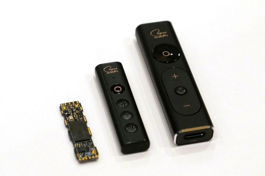 The Creative Sxfi Wire (centre) is a smaller version of the Sxfi Amp (right) targeted at third-party headphones maker to implement Creative's Super X-Fi 3D sound technology. On the left is the Super X-Fi chip.