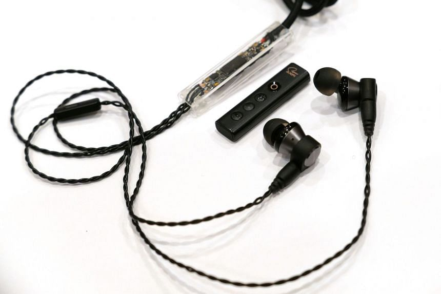 A mock-up showing how the Sxfi Wire can be implemented to existing headphones.