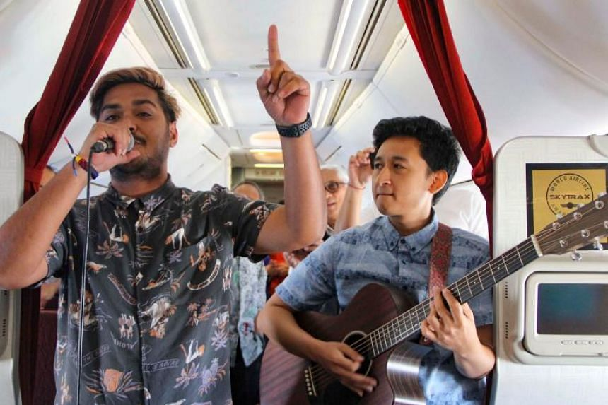 Passengers will be serenaded with live acoustic concerts in a scheme aimed at wooing millennials.PHOTO: AFP